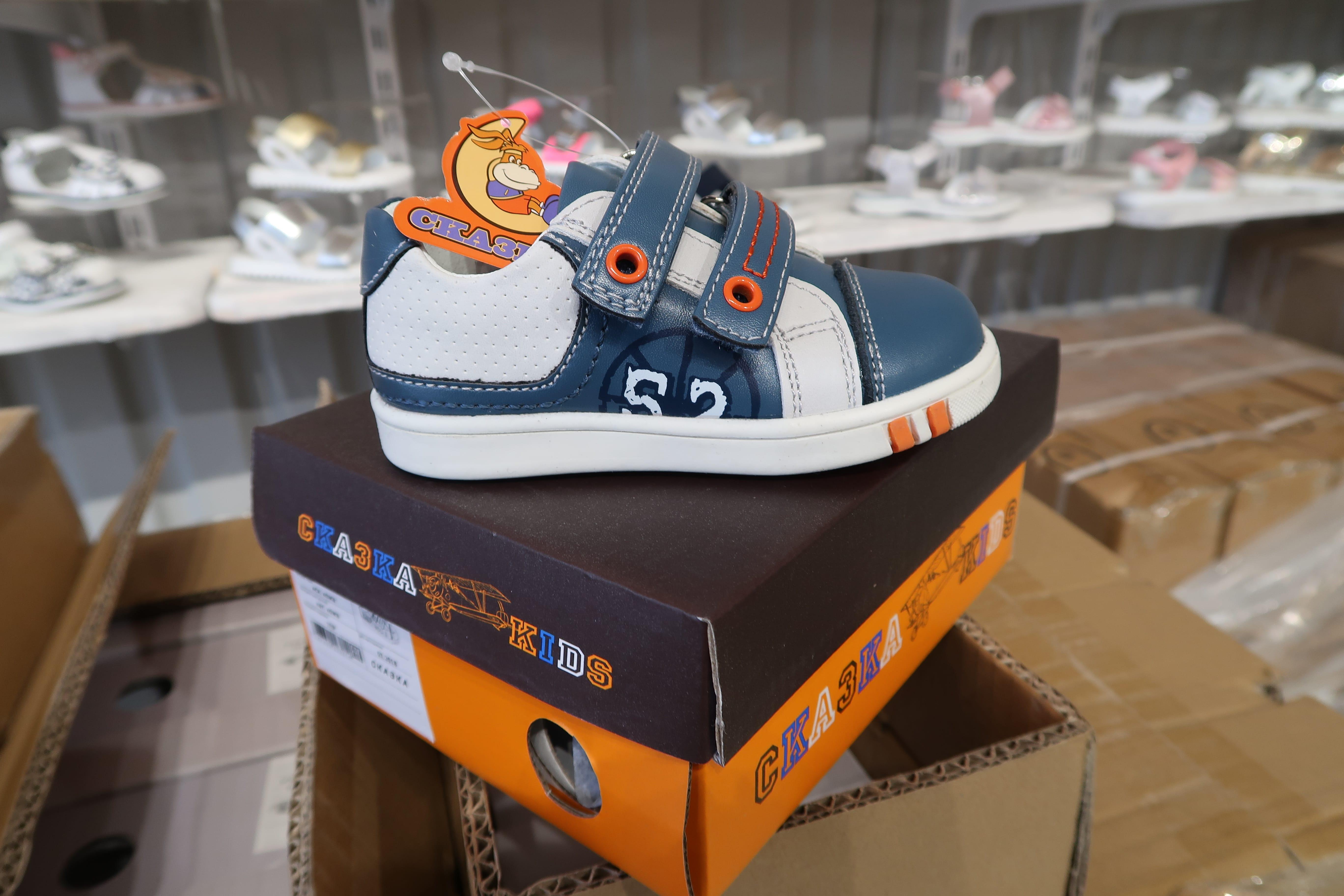 Упаковка дитячого взуття оптом